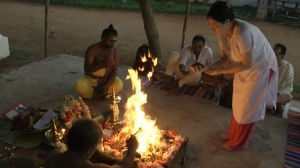 Trip attendees participating in a homa (sacred fire ritual)