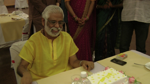 Baba cutting His birthday cake during His birthday trip 2012