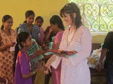 Tripura Foundation's Lalita giving out Diwali sarees for HoPE Center children